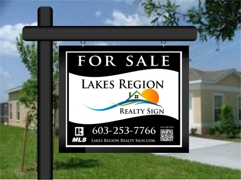 A  For Sale  sign for Lakes Region Realty
